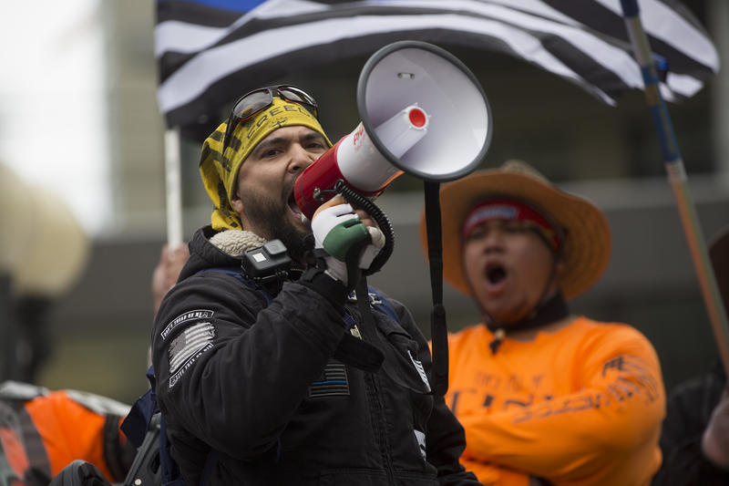 Organizer Joey Gibson of the Vancouver, Washington-based group Patriot Prayer speaks during a pro-Trump rally at Westlake Plaza in downtown Seattle on Monday, May 1, 2017.