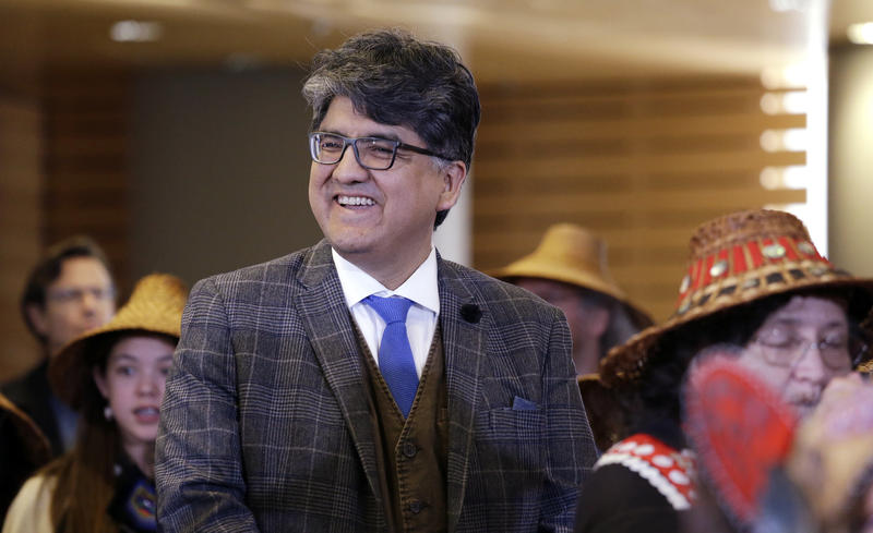 Author and filmmaker Sherman Alexie waits with dancers backstage for his turn on stage as the keynote speaker at a celebration of Indigenous Peoples' Day Monday, Oct. 10, 2016, at Seattle's City Hall.