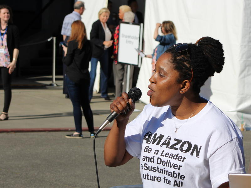SEIU organizer Patience Malaba leads a protest while Amazon shareholders enter the company's annual shareholders meeting in Seattle in May.