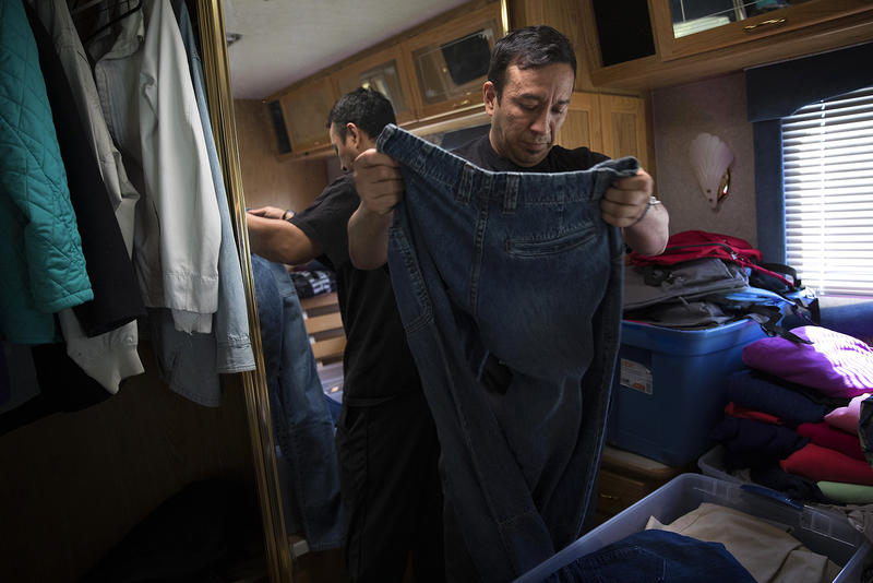 Selso Olivan looks for a pair of pants that will fit him in the Advocates for Immigrants in Detention Northwest R.V., after he was released from the Northwest Detention Center on Wednesday, June 21, 2017, in Tacoma, Washington. Olivan, a single father of