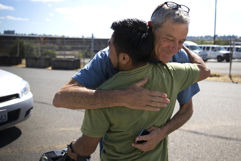 Scott Goddard hugs Alexi Martinez before he gets into an uber headed for Seattle-Tacoma International Airport, after he was released from the Northwest Detention Center on Wednesday, June 21, 2017, in Tacoma.