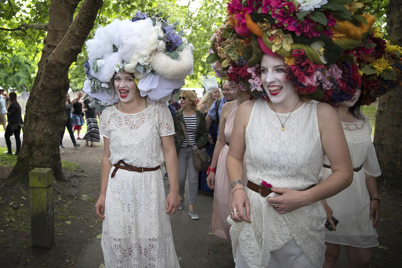 Charlotte Guard, left, and Anna MacCamy, right, laugh while wearing headpieces designed by artist Sofia Babaeva, during the Fremont Solstice Parade and Celebration. Click or tap on the image above for more pictures.