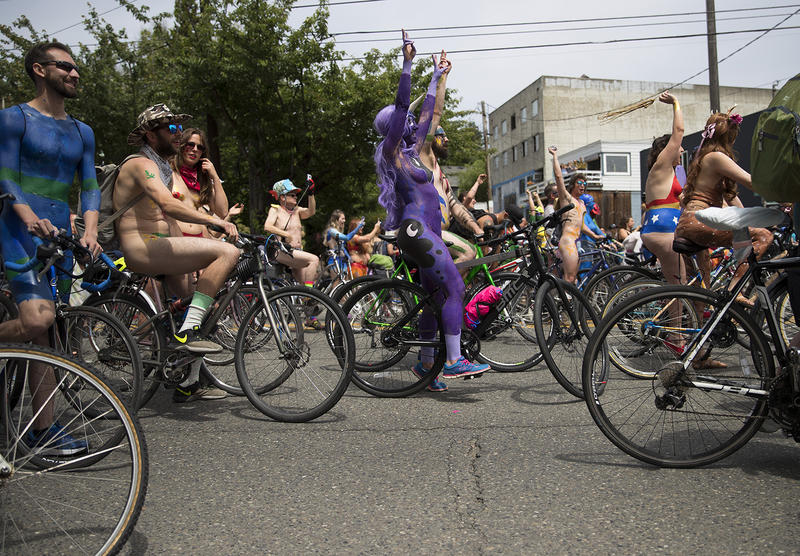 Naked cyclists prepare for the race on North 36th Street, during the Fremont Solstice Parade.