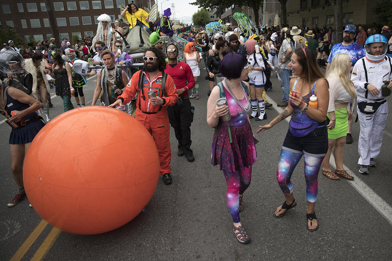 Parade-goers march during the Fremont Solstice Parade.