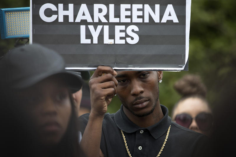 Chris Cressel, a cousin of Charleena Lyles, holds a sign during a press conference at the Solid Ground Brettler Family Place on Tuesday, June 19, 2017, in Seattle, Washington.