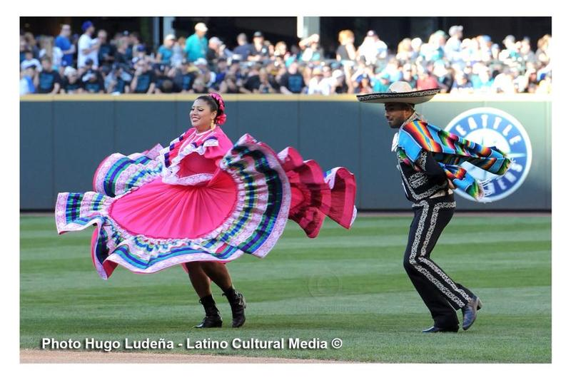 Members of Bailodores de Bronce entertain baseball fans at a Seattle Mariners' game