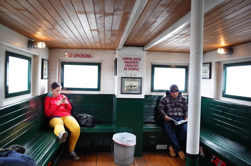 Passengers on Kitsap Transit's Port Orchard -Bremerton ferry. Soon a modern vessel will take on a new route - Bremerton to Seattle.
