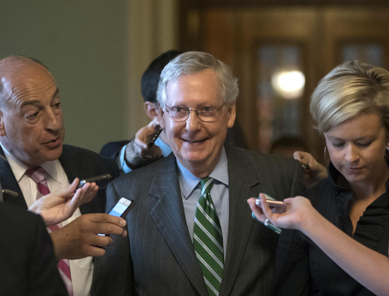 FILE: Senate Majority leader Mitch McConnell smiles as he leaves the chamber after announcing the release of the Republicans' health care bill Thursday, June 22, 2017.
