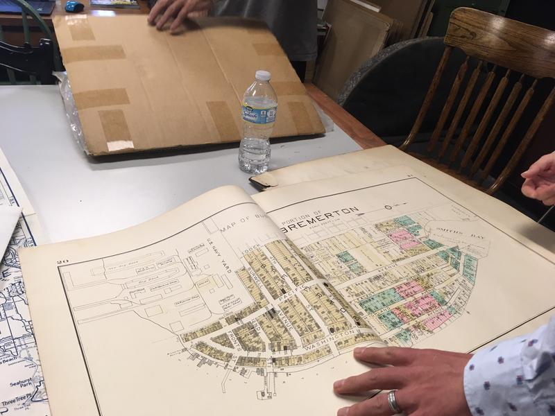 This is among the old maps being looked at by local history buffs in the back of a Bremerton shop.