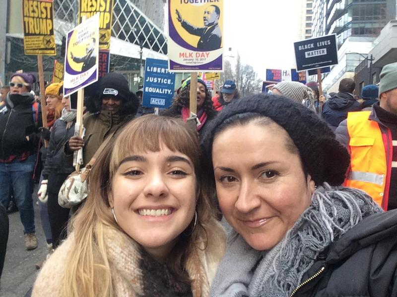 The author (left) with her mother, Maria Espinoza, at the Womxn's March on Seattle in January 2017.