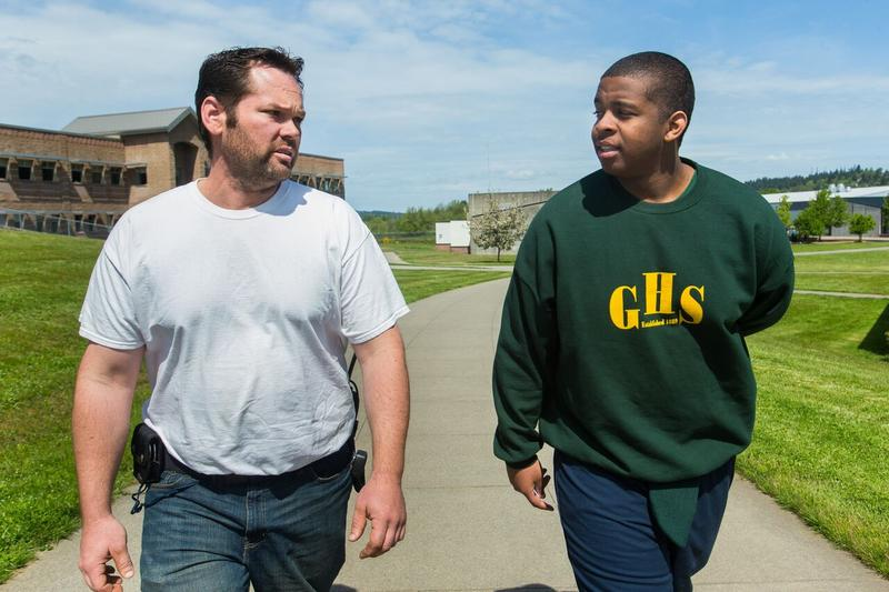 Diontae Moore-Lyons, 17, right, is escorted back to his unit by manager Shawn Northcutt at Green Hill School in Chehalis, Wash., on Wednesday, May 10, 2017. Green Hill School is a medium/maximum security, fenced facility for teenage male offenders.
