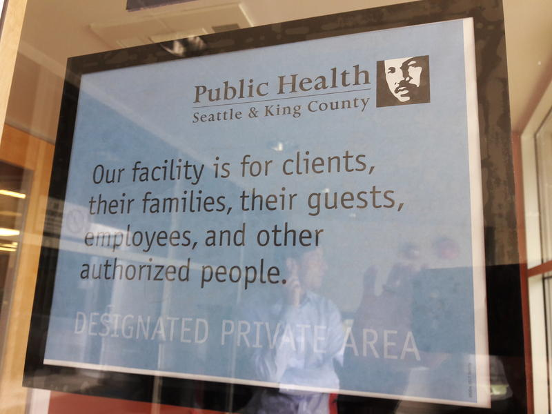 Signs posted at Public Health Seattle-King County clinics designates waiting rooms as private areas.
