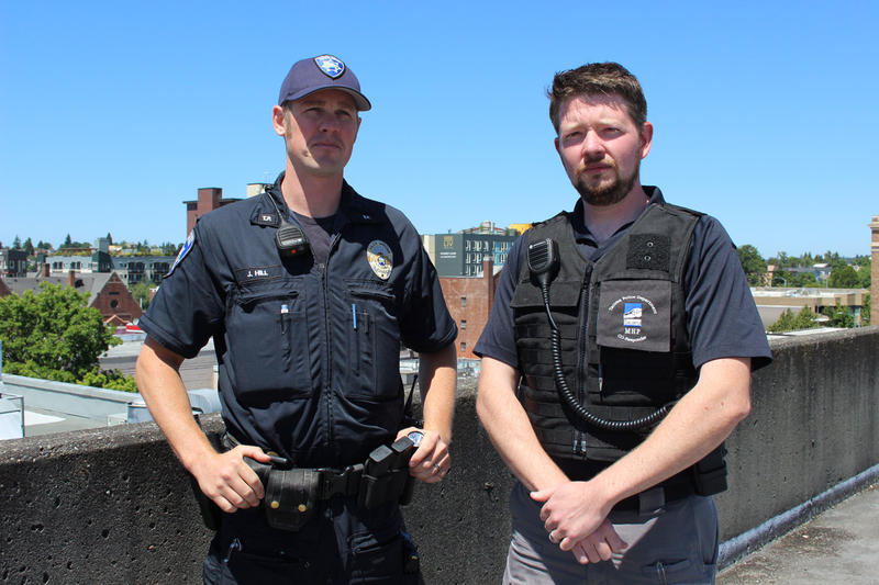 Officer John Hill and Ryan Miles, a designated mental health professional with the Tacoma Police Department.