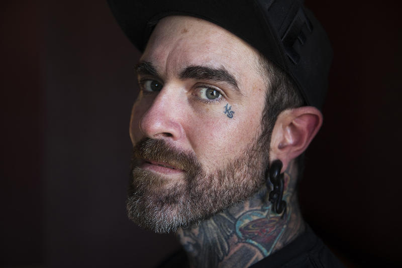 Tattoo artist Paul Weaver, 35, poses for a portrait on Thursday, June 29, 2017, at Brem City Tattoo, in Bremerton, Washington.