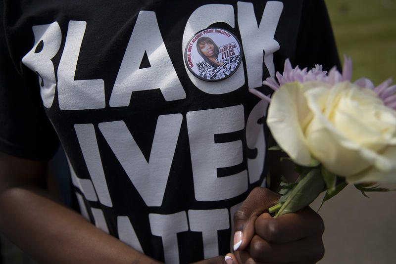 A mourner at Charleena Lyles' burial on Monday, July 10, 2017 wears a 'Black Lives Matter' shirt. Lyles was shot by Seattle Police on June 18.