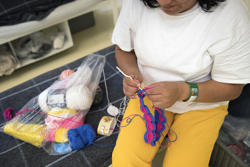 An immigrant detainee knits at the Northwest Detention Center in Tacoma.
