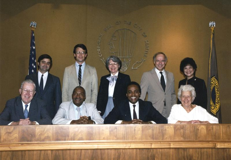 Seattle City Council in 1985. Norm Rice, mayor from 1989 to 1997, is in front center. Dolores Sibongo is back, far right. Consultant Cathy Allen said that the political influencers told Sibongo that it was 'Norm's turn.'