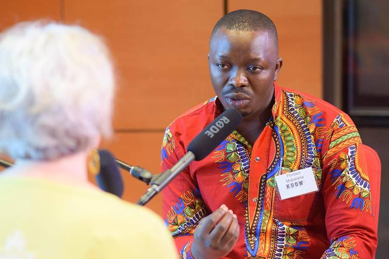 Floribert Mubalama speaks with Julia Donk about his experiences as an immigrant on  July 22, 2017 as part of KUOW's Ask An Immigrant event.