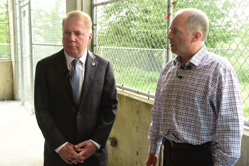 Seattle Mayor Ed Murray and Daniel Malone with DESC stand in front of a pet relief area at the Navigation Center