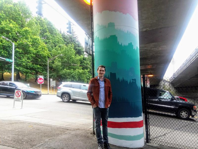 Nathan Watkins, the designer of 68 Interstate 5 pillars between Cherry and James Streets in downtown Seattle.