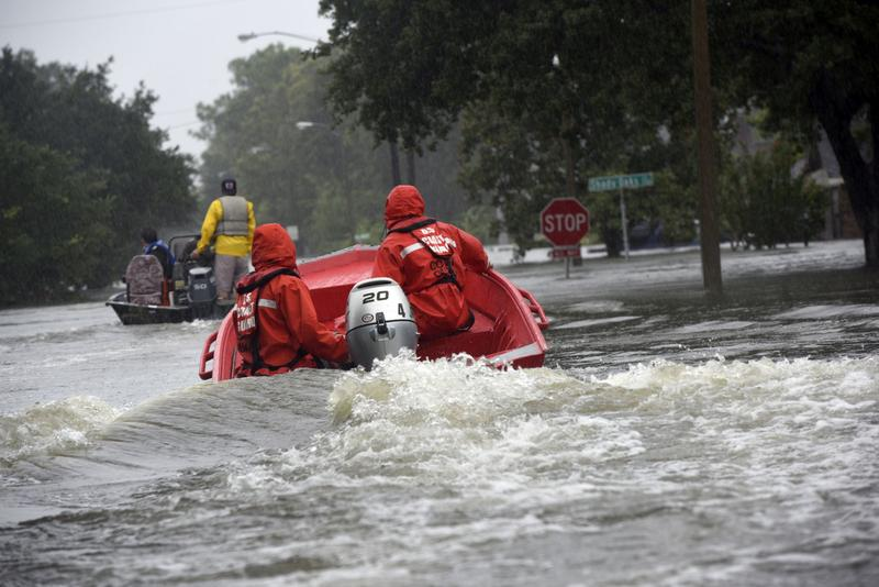 Coast Guard Petty Officers 3rd Class Eric Gordon and Gavin Kershaw pilot a 16-foot flood punt boat and join good Samaritans in patrolling a flooded neighborhood in Friendswood, Texas, Aug. 29, 2017. The flood punt team from Marine Safety Unit Paducah, Ken