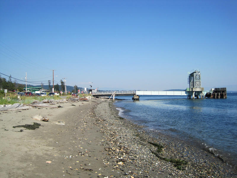 View of the Guemes Island ferry dock from the beach. The Guemes Island ferry is Skagit County's only ferry, with 20 runs a day.