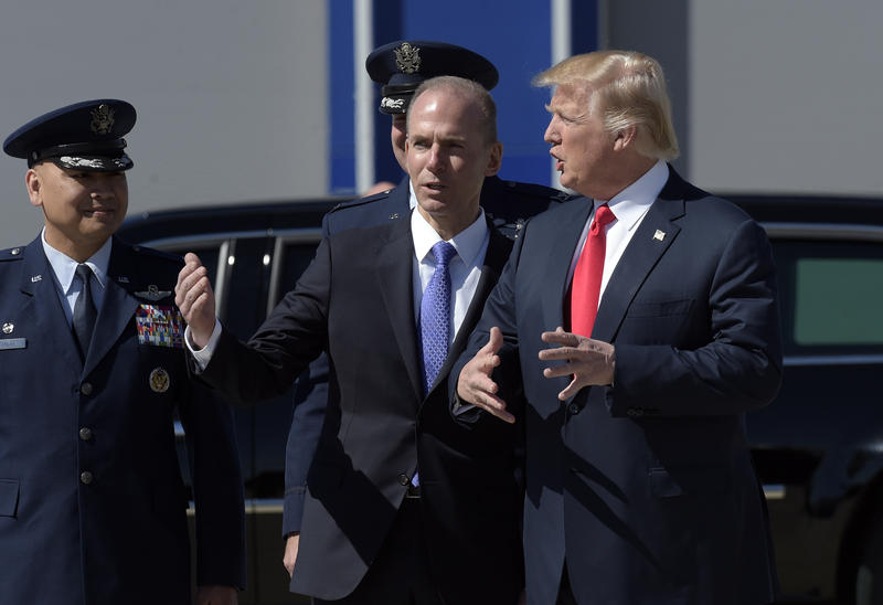 President Donald Trump talks with Boeing CEO Dennis Muilenburg upon his arrival on Air Force One at Charleston International Airport in North Charleston, S.C., Friday, Feb. 17, 2017.