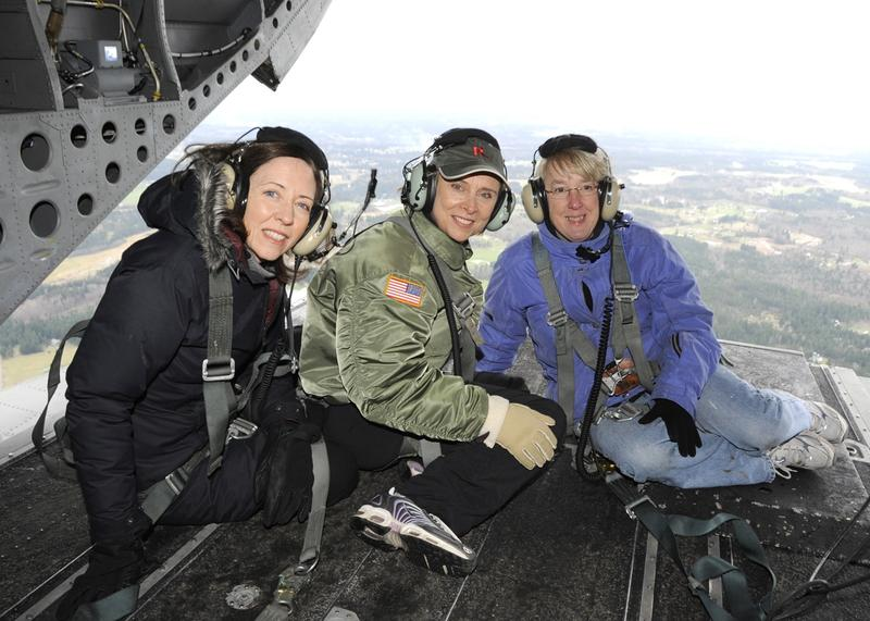 From left, U.S. Sen. Maria Cantwell, former Gov. Chris Gregoire and U.S. Sen. Patty Murray at the back of a helicopter overlooking a flood zone in Washington state. Story goes that only the women in the WA delegation were brave enough to scoot this far.