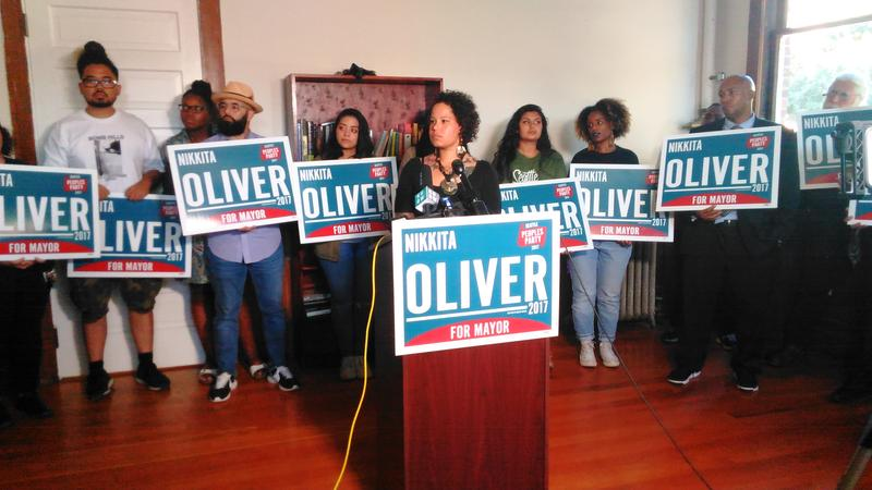 Nikkita Oliver, surrounded by supporters, declares 3rd place in Seattle's mayoral race a victory