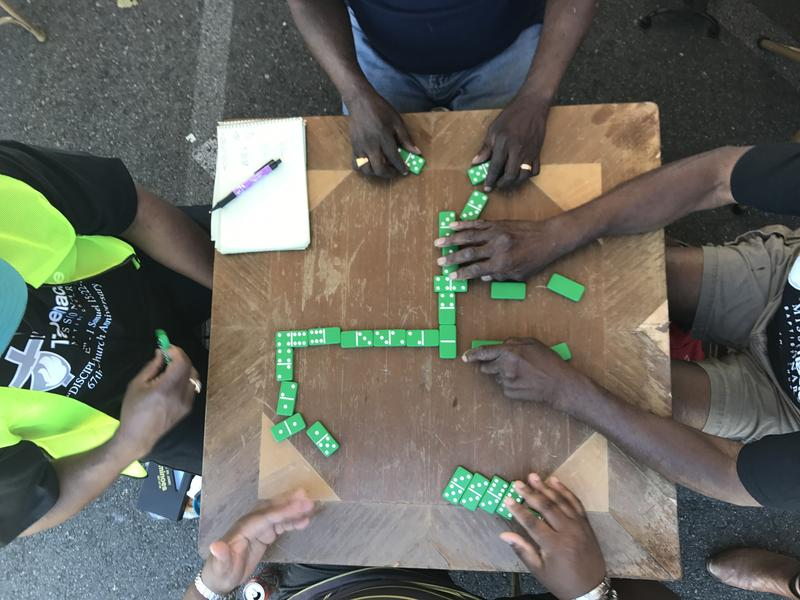A game of dominoes at the Tabernacle Missionary Baptist Church Barbeque.