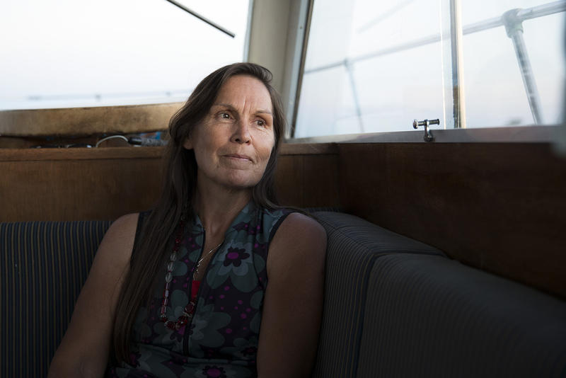 Deborah Alexander, one of the many people who were tribally disenrolled from the Nooksack tribe, looks out of the window of a safety boat during the first leg of a canoe journey on Thursday, July 27, 2017, in Point Roberts.