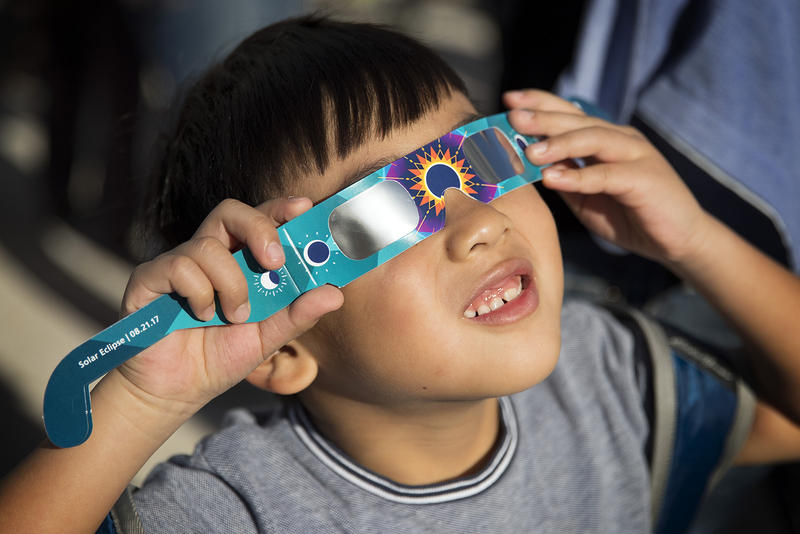 Stanley Liu, 6, looks toward the sun during the solar eclipse on Monday, August 21, 2017, at the Pacific Science Center on 2nd Ave., in Seattle.