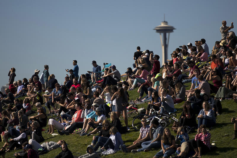 A crowd looks toward the sun during the solar eclipse on Monday, August 21, 2017, at Gas Works Park in Seattle.