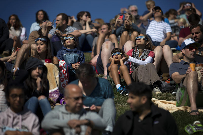 A crowd of people gathered at Gas Works Park on Monday, August 21, 2017, to watch the solar eclipse in Seattle. KUOW Photo/Megan Farmer
