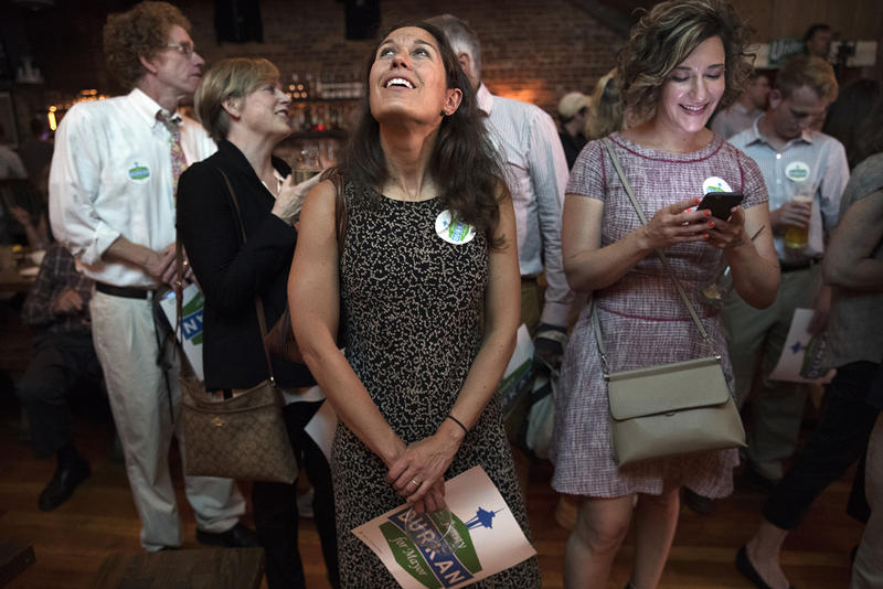 Campaign volunteer Sarah Hillman smiles while looking at the results during an election night event for mayoral candidate Jenny Durkan on Tuesday, August 1, 2017, at Altstadt Bierhall & Brathaus on 1st Ave. S., in Seattle.