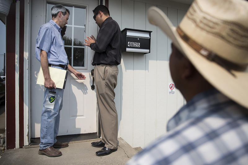 Attorney Joe Morrison, left, attempts to enter the offices of Sarbanand Farms on Wednesday, August 8, 2017, on Rock Road in Sumas, Washington.
