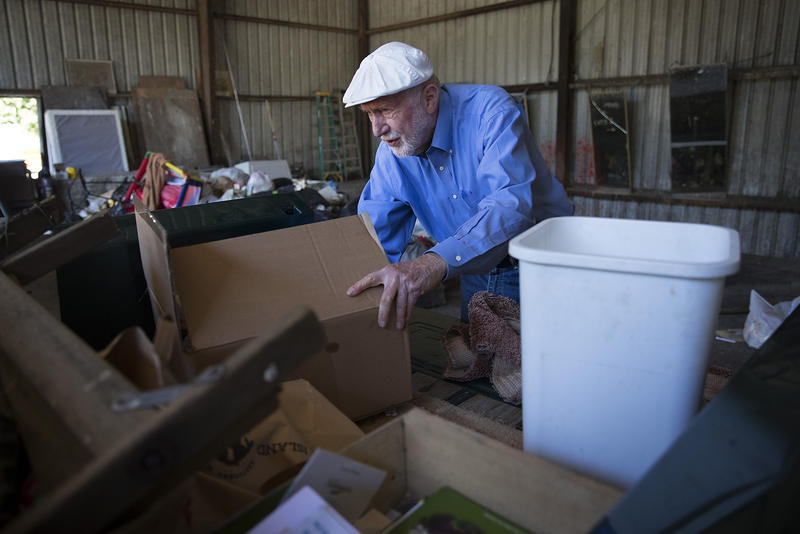 David Williams, a 20-year full-time resident of Orcas Island, sorts through garbage and recycling in the back of his truck on Sunday, July 30, 2017, on the tipping floor of the Orcas Island Transfer Station on Orcas Island. KUOW Photo/Megan Farmer