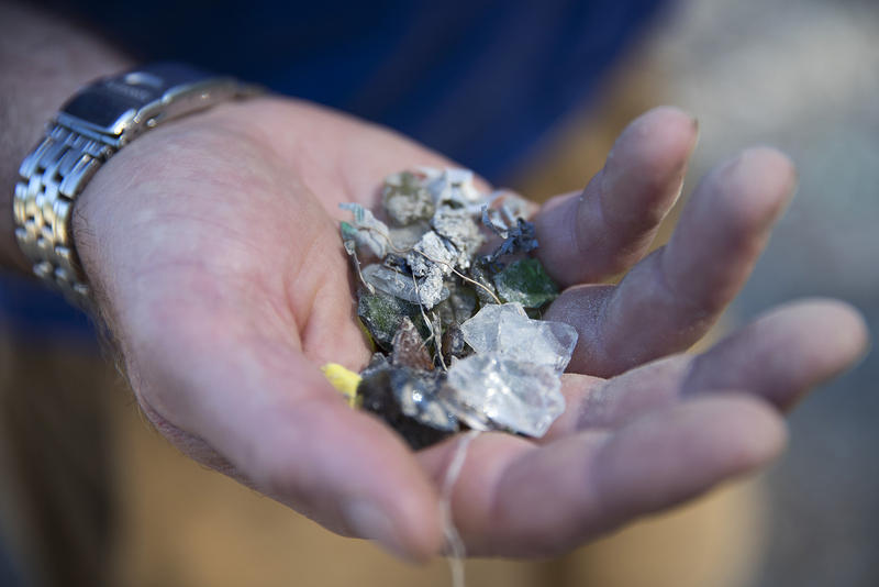 Pete Moe, Executive Director of Orcas Recycling Services/The Exchange, holds a handful of crushed glass that is sometimes used to create pathways or fill ditches, on Sunday, July 30, 2017, at the Orcas Island Transfer Station on Orcas Island.