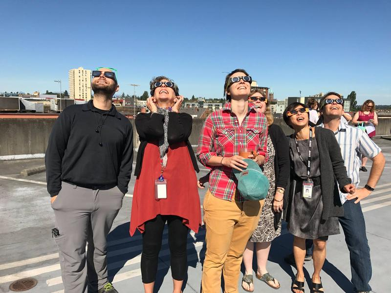 KUOW staff gathered on the garage roof to watch the eclipse. From left, Matt Albertson, Marcie Sillman, Elizabeth Hovance, Carol Smith, Ruby de Luna, Joshua McNichols.