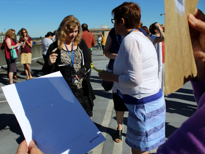 KUOW producer Katherine Banwell watched the eclipse through a pinhole on the roof of the parking garage.