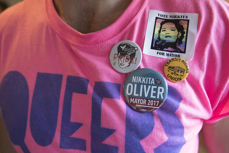 Volunteer Bradley Horst sports Nikkita Oliver pins during Oliver's election night event on Tuesday, August 1, 2017, at Washington Hall on 14th St., in Seattle.