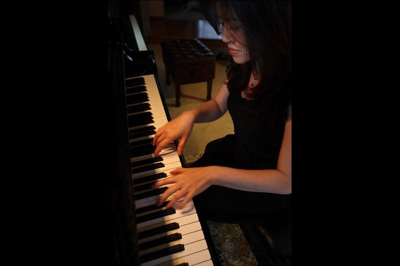 Piano teacher and composer Yiling Huang was classically-trained in Vienna, Austria. She said that music composers must connect deeply with their subject matter.