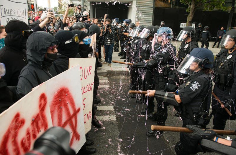 Protesters sprayed Seattle Police with silly string moments before attempting to break the line. Seattle, August 13, 2017.