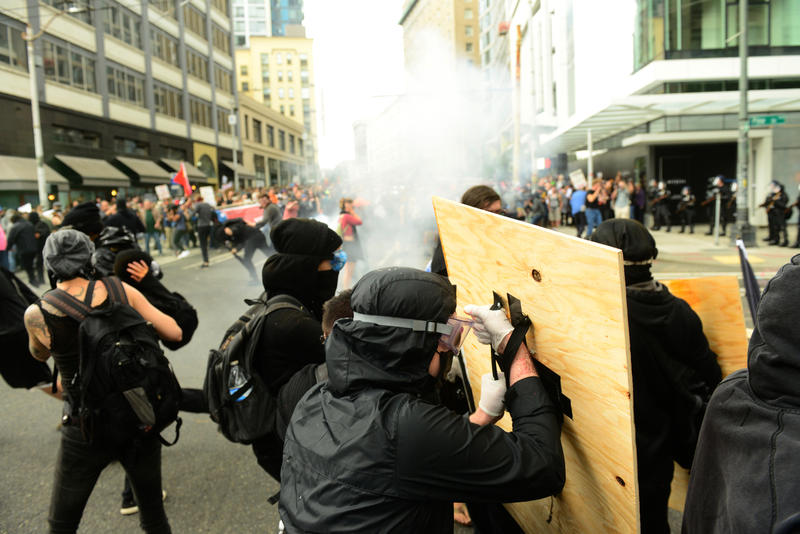 Seattle Police attempt to disperse the anti-fascist protesters with flash-bangs and pepper spray. Seattle, August 13, 2017.
