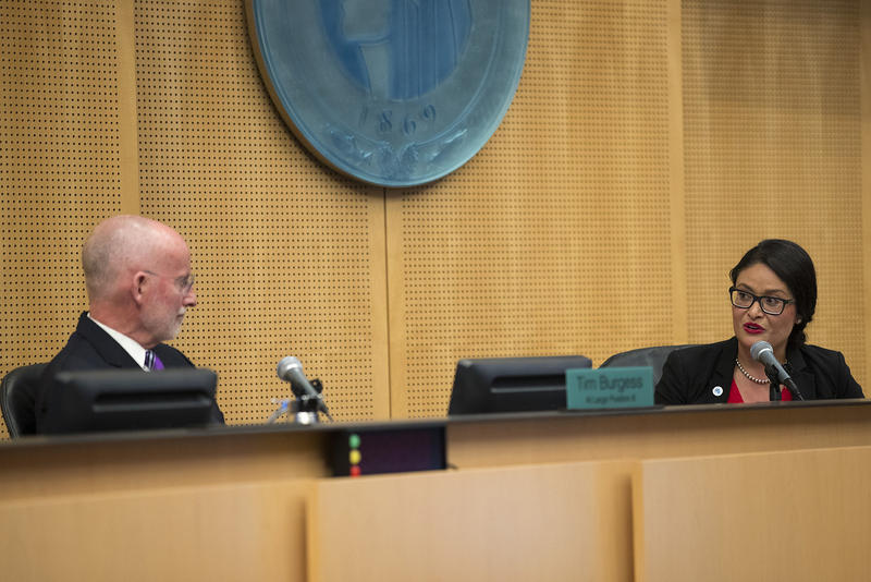 Councilmember Lorena Gonzalez, right, nominates Councilmember Tim Burgess to be the interim mayor of Seattle on Monday, September 18, 2017, at City Hall in Seattle.
