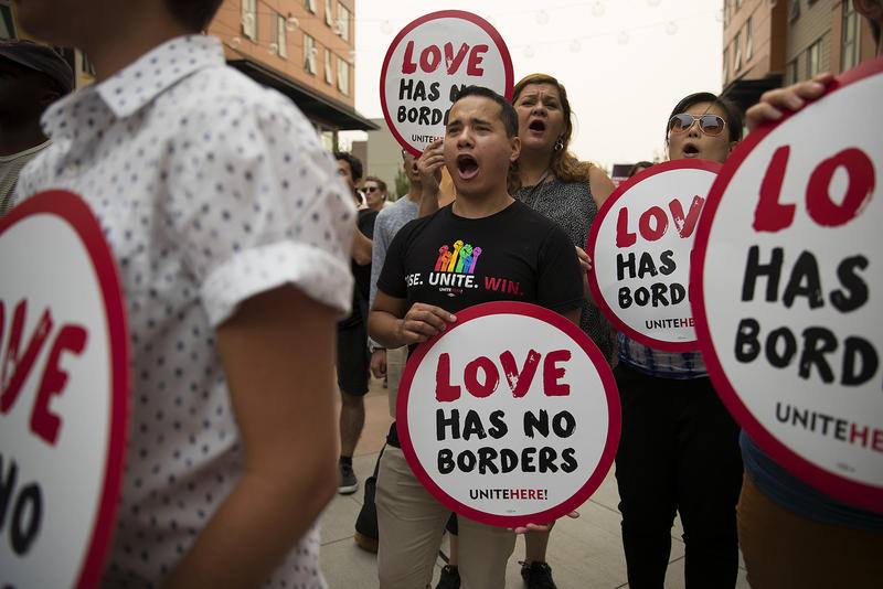 Emmanuel Carrillo, center, with UNITE HERE, the Hospitality Worker's Labor Union, chants during a community rally in support of DACA recipients on Tuesday.