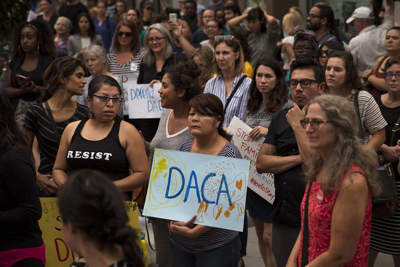 A crowd gathers during a community rally in support of DACA recipients on Tuesday, September 5, 2017, at El Centro De La Raza in Seattle.
