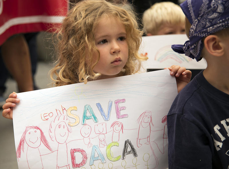 Leona, a student at the Jose Marti Child Development Center holds a Save DACA sign during a community rally in support of DACA recipients on Tuesday, September 5, 2017, at El Centro De La Raza in Seattle.