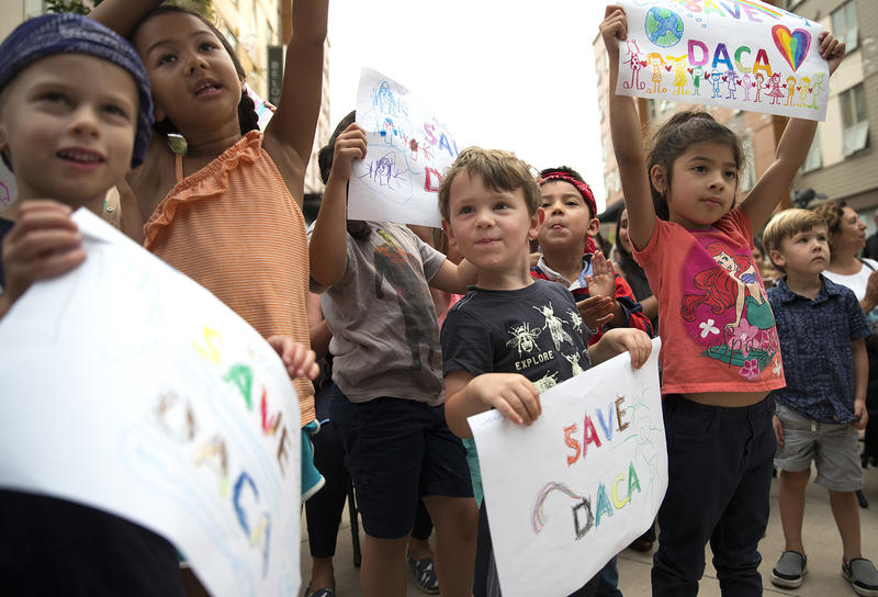 Students from the Jose Marti Child Development Center gather during a community rally in support of DACA recipients on Tuesday, September 5, 2017, at El Centro De La Raza in Seattle.