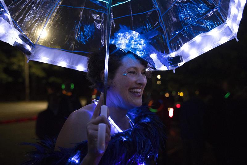 Debbie Schorzman laughs during the Luminata lantern parade on Thursday, September 21, 2017, at Green Lake in Seattle.